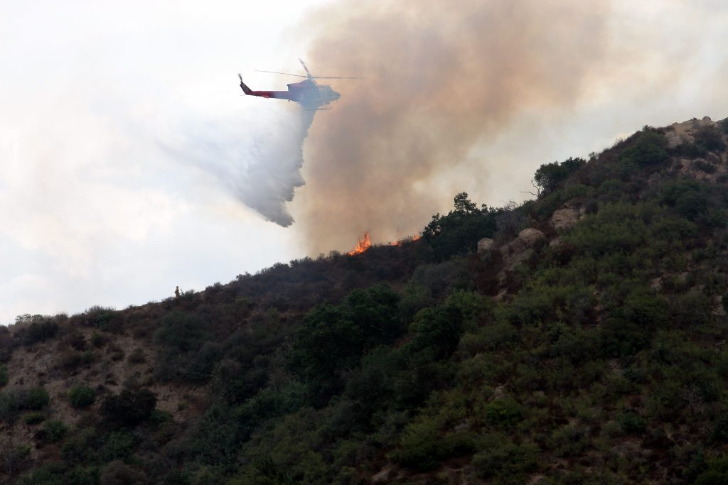 LA City Fire Department Helicopter dropping water on a fire in the Hollywood Hills