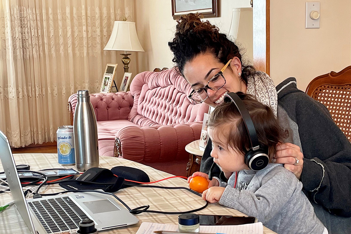 Veronica Diaz working from home alongside her daughter, Emma.